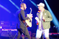 "Watch Will Ferrell Add More Cowbell To Chris Martin's ""Viva La Vida"" At Cancer For College Benefit"