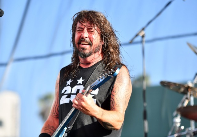 Foo Fighters' Dave Grohl downs beer and falls of stage during gig