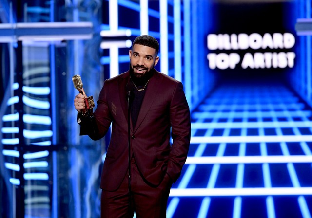 Drake Gets Beatles Tattoo After Beating Their Billboard Records