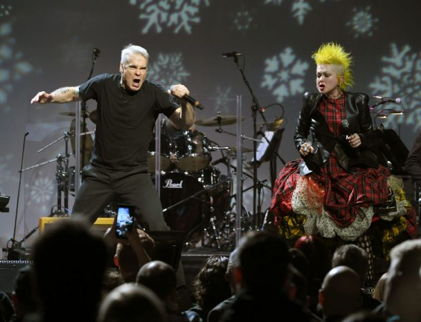 """Henry Rollins & Cyndi Lauper Sing Black Flag's """"Rise Above"""" At Home For The Holidays Benefit: Watch"""