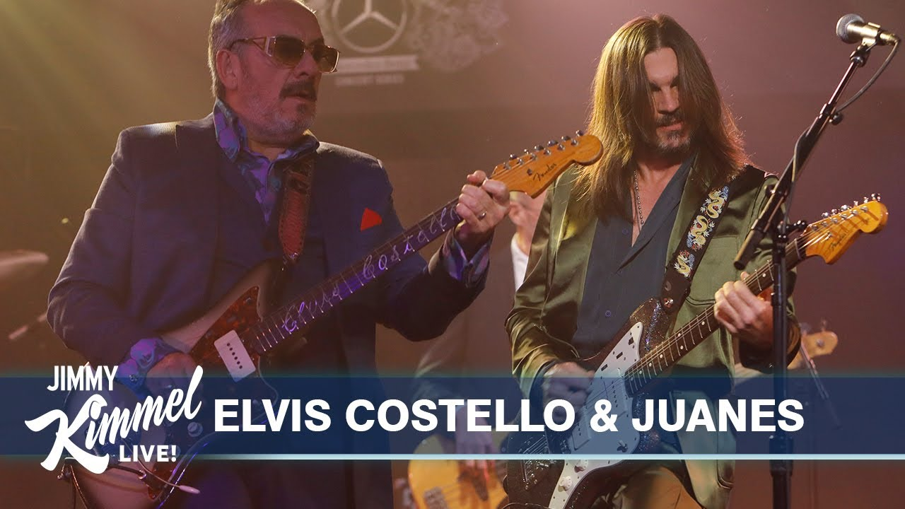 """Watch Elvis Costello Play A Bilingual """"Pump It Up"""" With Juanes & Give Jimmy Kimmel A Guitar Lesson"""