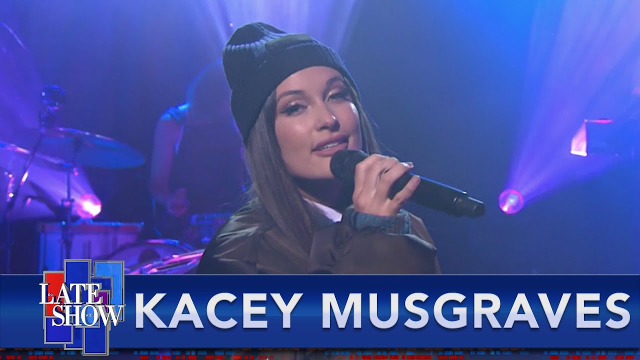 "Watch Kacey Musgraves Sing ""Breadwinner"" & Make It Rain On Colbert"